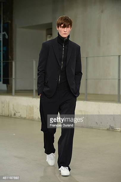 A model walks the runway during the Carven show as part of the Paris Fashion Week Menswear Spring/Summer 2015 on June 25 2014 in Paris France