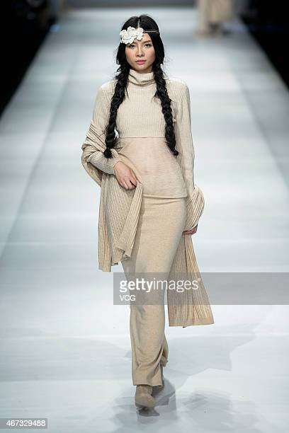 A model walks the runway during the CASHMERE show as part of the Shenzhen Fashion Week A/W 2015 at OCT Harbour on March 23 2015 in Shenzhen China