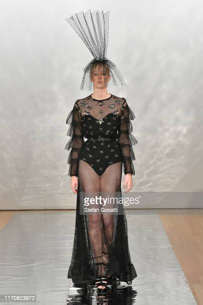 A model walks the runway during the Cecilia Kang Couture Face Me MakeUp show during New Zealand Fashion Week 2019 at Auckland Town Hall on August 29...