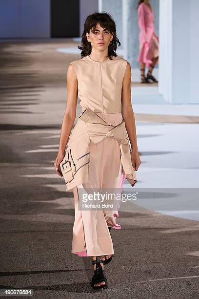 A model walks the runway during the Cedric Charlier show as part of the Paris Fashion Week Womenswear Spring/Summer 2016 at Cite de la Mode et du...