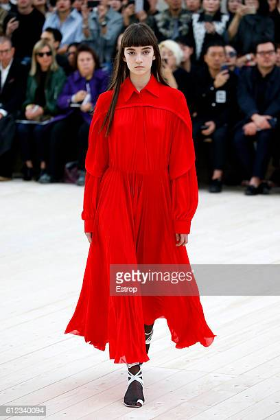 A model walks the runway during the Celine designed by Phoebe Philo show as part of the Paris Fashion Week Womenswear Spring/Summer 2017 on October 2...
