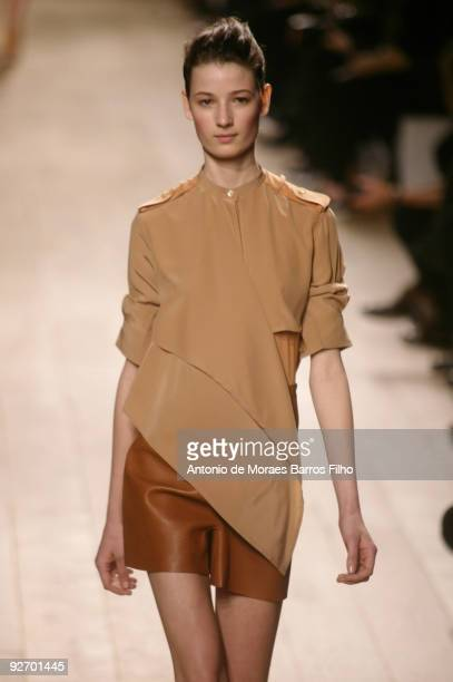 A model walks the runway during the Celine Pret a Porter show as part of the Paris Womenswear Fashion Week Spring/Summer 2010 on October 5 2009 in...