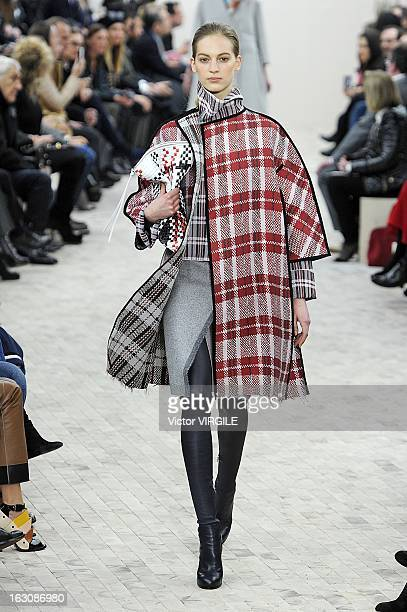 Model walks the runway during the Celine Ready to Wear Fall/Winter 2013-2014 show as part of the Paris Fashion Week on March 03, 2013 in Paris,...