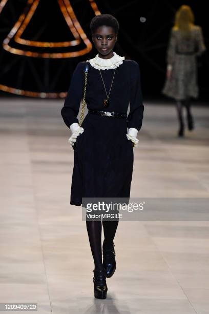 Model walks the runway during the Celine Ready to Wear fashion show as part of the Paris Fashion Week Womenswear Fall/Winter 2020-2021 on February...