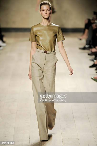 Model walks the runway during the Celine Ready To Wear show as part of the Paris Womenswear Fashion Week Spring/Summer 2010 on October 5, 2009 in...