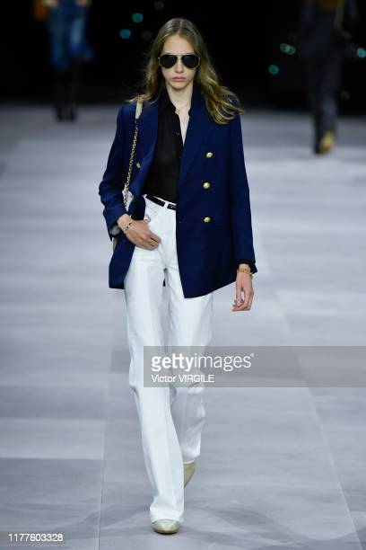 Model walks the runway during the Celine Ready to Wear Spring/Summer 2020 fashion show as part of Paris Fashion Week on September 27, 2019 in Paris,...