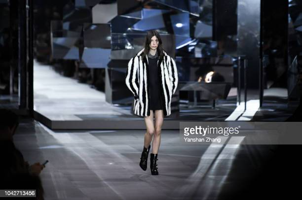 Model walks the runway during the Celine show as part of the Paris Fashion Week Womenswear Spring/Summer 2019 on September 28, 2018 in Paris, France.