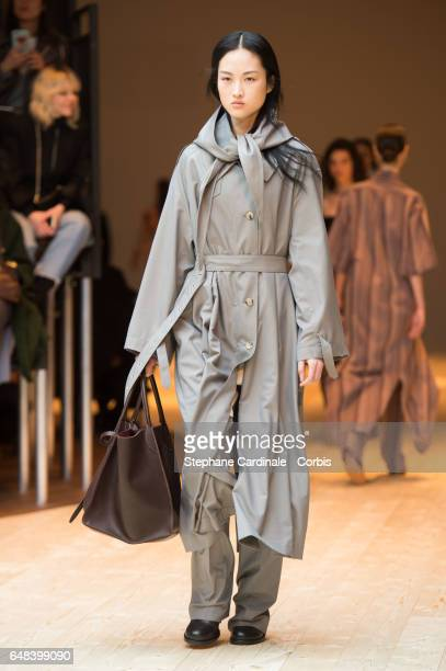 A model walks the runway during the Celine show as part of the Paris Fashion Week Womenswear Fall/Winter 2017/2018 on March 5 2017 in Paris France