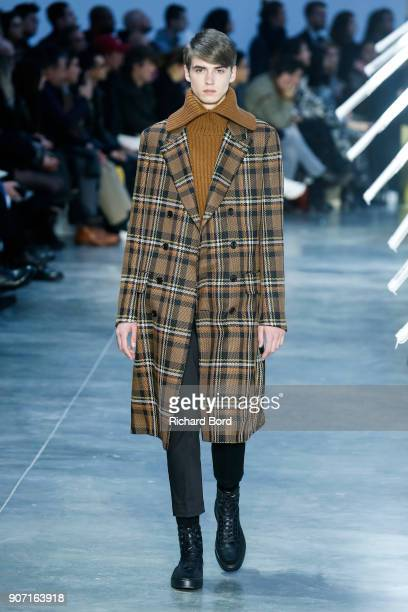 A model walks the runway during the Cerruti 1881 Menswear Fall/Winter 20182019 show at Palais de Tokyo as part of Paris Fashion Week on January 19...