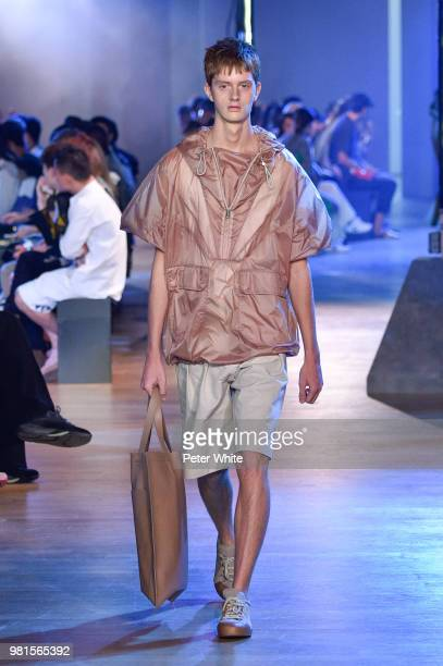A model walks the runway during the Cerruti 1881 Menswear Spring/Summer 2019 show as part of Paris Fashion Week on June 22 2018 in Paris France