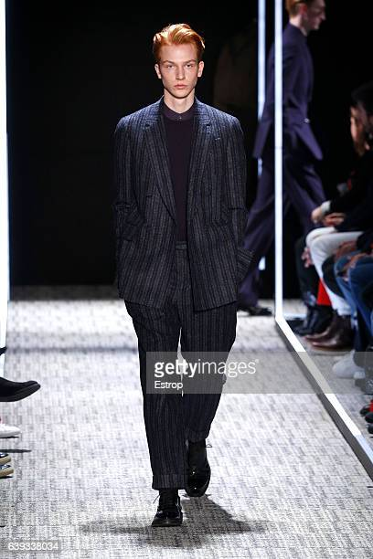 A model walks the runway during the Cerruti designed by Richard Nicoll Menswear Fall/Winter 20172018 show as part of Paris Fashion Week on January 20...