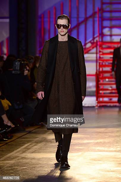 A model walks the runway during the Cerruti Menswear Fall/Winter 20142015 show as part of Paris Fashion Week on January 17 2014 in Paris France