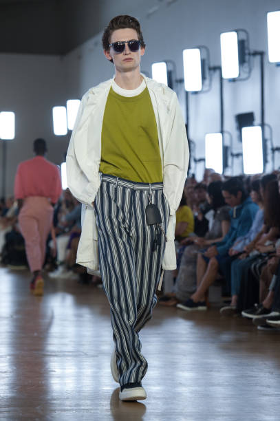 0e0cb8d94e14 A model walks the runway during the Cerruti Menswear Spring Summer 2018  show as part