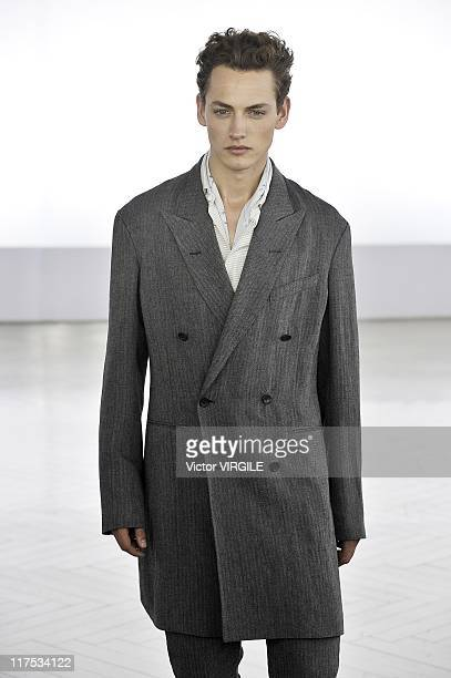 A model walks the runway during the Cerruti Ready to Wear Spring/Summer 2012 show as part of the Paris Men Fashion Week on June 25 2011