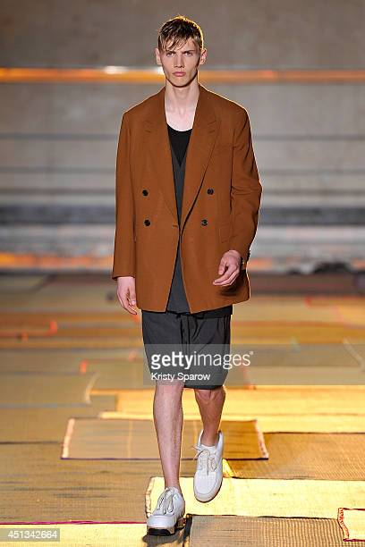 A model walks the runway during the Cerruti show as part of Paris Fashion Week Menswear Spring/Summer 2015 on June 27 2014 in Paris France