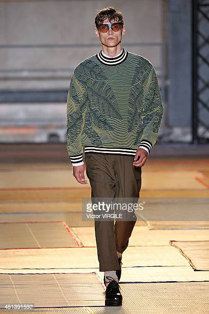 A model walks the runway during the Cerruti show as part of the Paris Fashion Week Menswear Spring/Summer 2015 at Espace Vendome on June 27 2014 in...