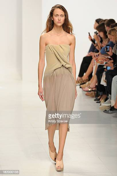 A model walks the runway during the Chalayan show as part of Paris Fashion Week Womenswear Spring/Summer 2014 on September 27 2013 in Paris France