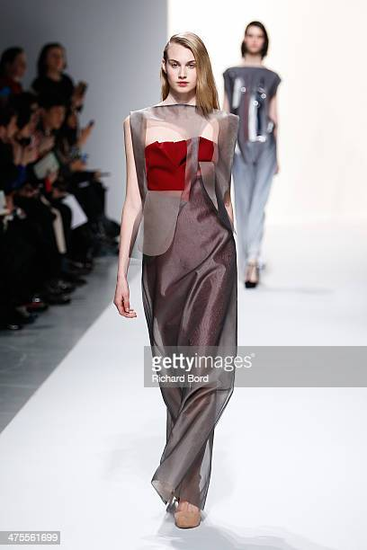 Model walks the runway during the Chalayan show as part of the Paris Fashion Week Womenswear Fall/Winter 2014-2015 at Les Beaux Arts on February 28,...