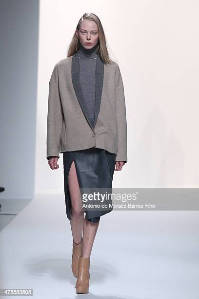Model walks the runway during the Chalayan show as part of the Paris Fashion Week Womenswear Fall/Winter 2014-2015 on February 28, 2014 in Paris,...