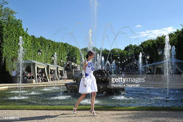 Model walks the runway during the Chanel 2012/13 Cruise Collection at Chateau de Versailles on May 14, 2012 in Versailles, France.