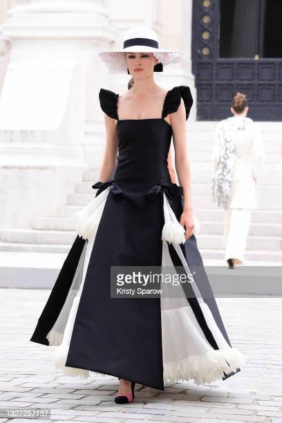 Model walks the runway during the Chanel Couture Haute Couture Fall/Winter 2021/2022 show as part of Paris Fashion Week on July 06, 2021 in Paris,...
