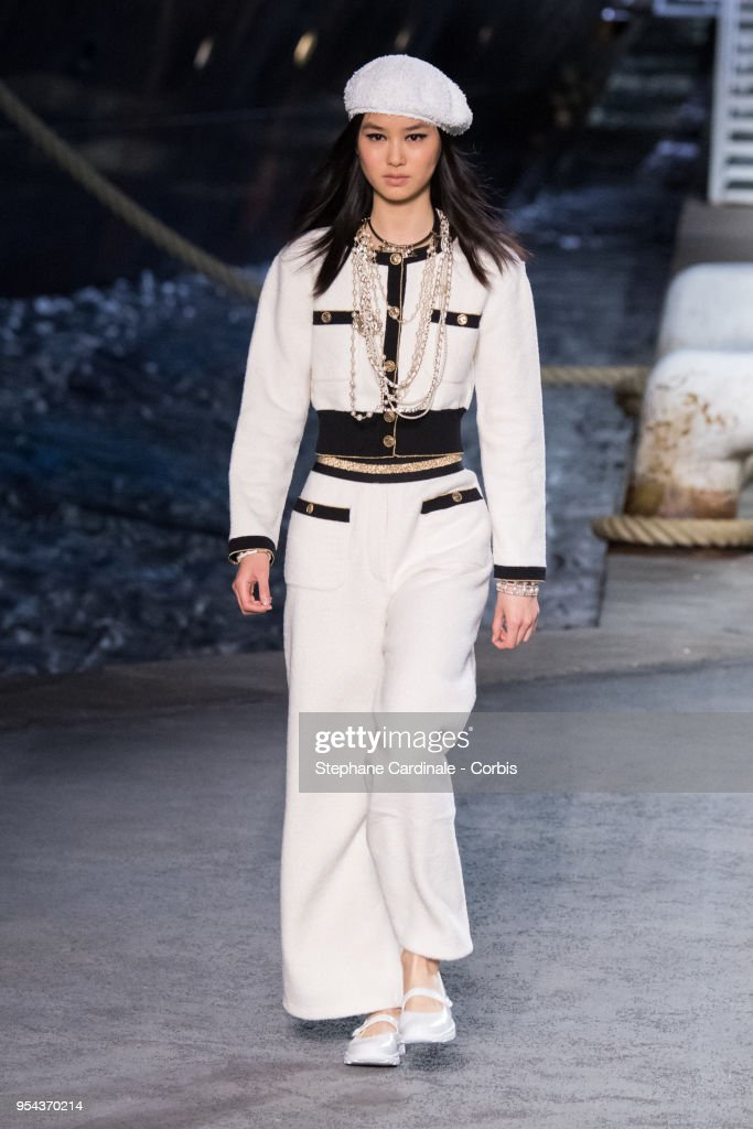 A model walks the runway during the Chanel Cruise 2018/2019 Collection at Le Grand Palais on May 3, 2018 in Paris, France.
