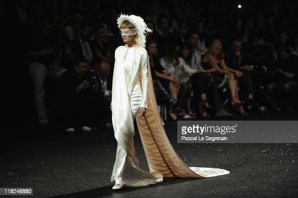 A model walks the runway during the Chanel Haute Couture Fall/Winter 2011/2012 show as part of Paris Fashion Week at Grand Palais on July 5 2011 in...
