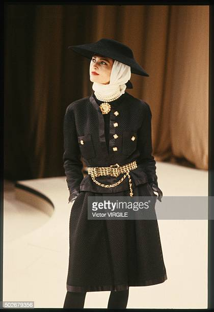 A model walks the runway during the Chanel Haute Couture show as part of Paris Fashion Week Fall/Winter 19881989 in July 1988 in Paris France