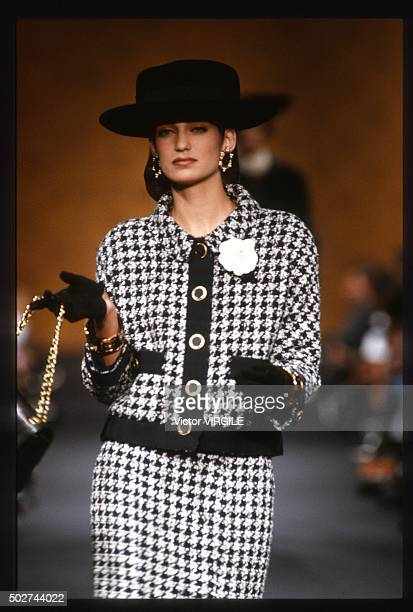 A model walks the runway during the Chanel Haute Couture show as part of Paris Fashion Week Fall/Winter 19891990 in July 1989 in Paris France