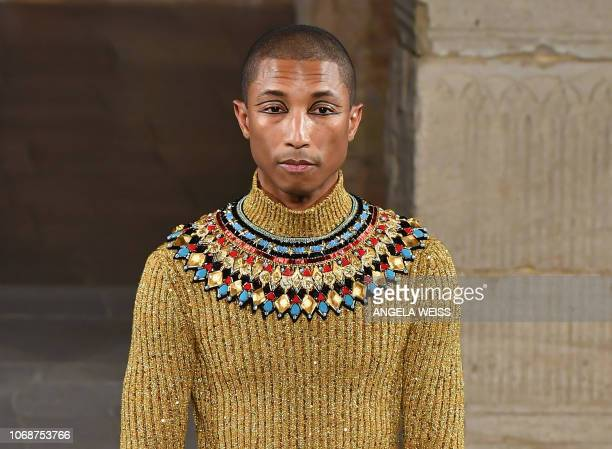 A model walks the runway during the Chanel Metiers D'Art 2018/19 Show at The Metropolitan Museum of Art on December 4 2018 in New York City