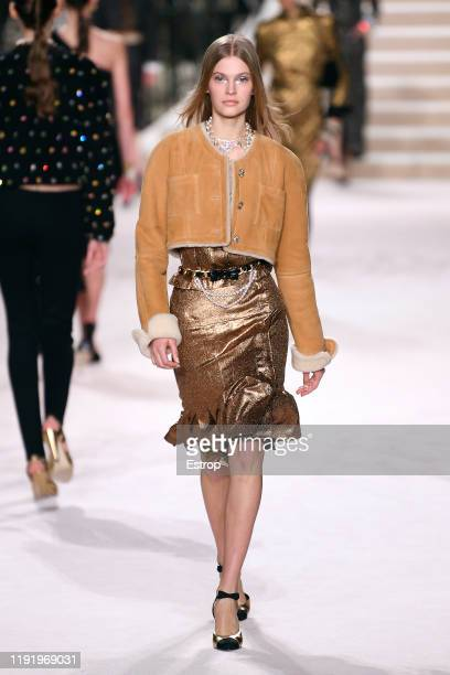 A model walks the runway during the Chanel Metiers d'art 20192020 show at Le Grand Palais on December 4 2019 in Paris France