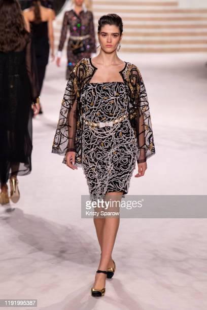 Model walks the runway during the Chanel Metiers d'Art 2019-2020 show at Le Grand Palais on December 04, 2019 in Paris, France.