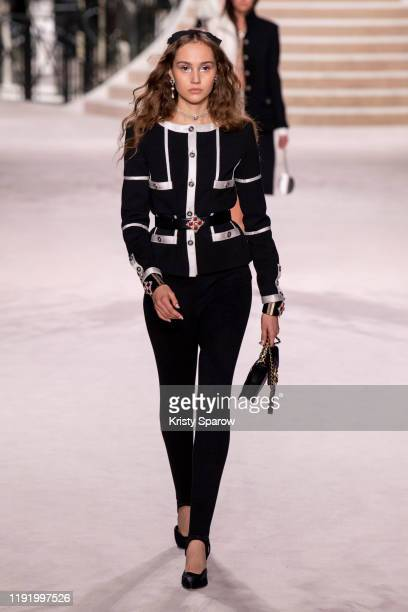 A model walks the runway during the Chanel Metiers d'Art 20192020 show at Le Grand Palais on December 04 2019 in Paris France