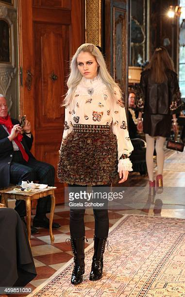 A model walks the runway during the Chanel Metiers d'Art Collection 2014/15 ParisSalzburg on December 2 2014 in Salzburg Austria