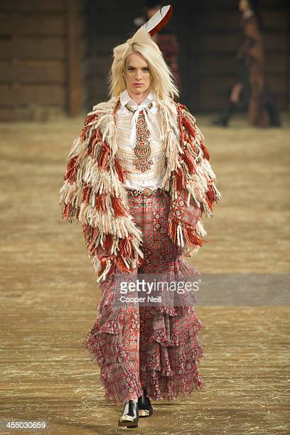 A model walks the runway during the Chanel Metiers d'Art Show at Fair Park on December 10 2013 in Dallas Texas