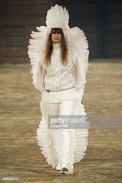 "Model walks the runway during the Chanel ""Metiers d'Art"" Show at Fair Park on December 10, 2013 in Dallas, Texas."