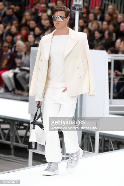 A model walks the runway during the Chanel Paris show as part of the Paris Fashion Week Womenswear Fall/Winter 2017/2018 on March 7 2017 in Paris...