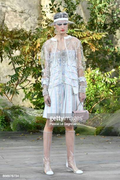 A model walks the runway during the Chanel Paris show as part of the Paris Fashion Week Womenswear Spring/Summer 2018 on October 3 2017 in Paris...