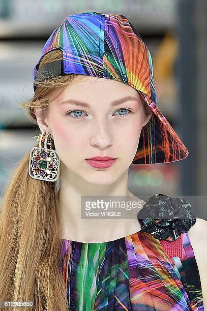 A model walks the runway during the Chanel Ready to Wear fashion show as part of the Paris Fashion Week Womenswear Spring/Summer 2017 on October 4...