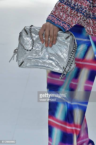 Model walks the runway during the Chanel Ready to Wear fashion show as part of the Paris Fashion Week Womenswear Spring/Summer 2017 on October 4,...