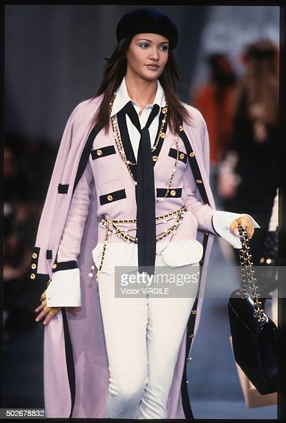 A model walks the runway during the Chanel Ready to Wear show as part of Paris Fashion Week Fall/Winter 19931994 in March 1993 in Paris France