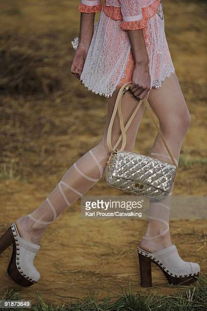 A model walks the runway during the Chanel Ready To Wear show as part of the Paris Womenswear Fashion Week Spring/Summer 2010