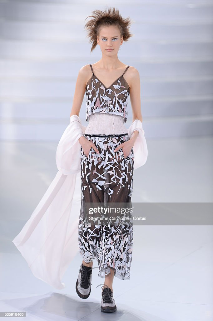 A model walks the runway during the Chanel show as part of Paris Fashion Week Haute-Couture Spring/Summer 2014, at Grand Palais in Paris.