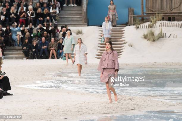 A model walks the runway during the Chanel show as part of the Paris Fashion Week Womenswear Spring/Summer 2019 on October 2 2018 in Paris France