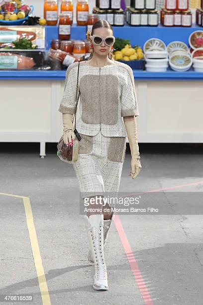 A model walks the runway during the Chanel show as part of the Paris Fashion Week Womenswear Fall/Winter 20142015 on March 4 2014 in Paris France