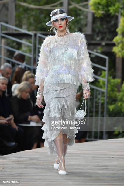 Model walks the runway during the Chanel show as part of the Paris Fashion Week Womenswear Spring/Summer 2018 on October 3, 2017 in Paris, France.