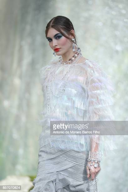 A model walks the runway during the Chanel show as part of the Paris Fashion Week Womenswear Spring/Summer 2018 on October 3 2017 in Paris France
