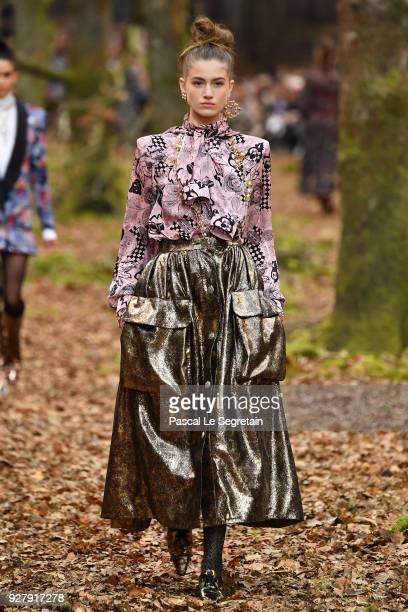 A model walks the runway during the Chanel show as part of the Paris Fashion Week Womenswear Fall/Winter 2018/2019 on March 6 2018 in Paris France