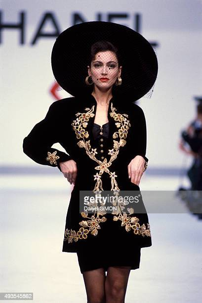 A model walks the runway during the Chanel show Haute Couture Fall/Winter 1987/1988 in Paris France on July 27 1987