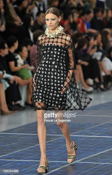 Model walks the runway during the Chanel Spring / Summer 2013 show as part of Paris Fashion Week at Grand Palais on October 2, 2012 in Paris, France.